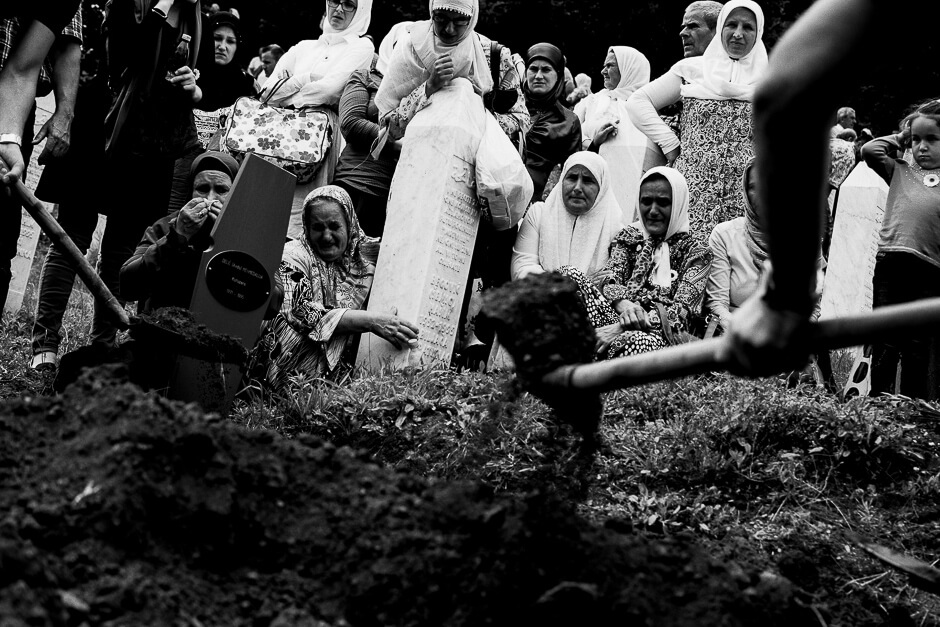 Muslim Bosnians burying the bodies of newly identified victims of genocide at the Srebrenica Potočari Memorial site.
