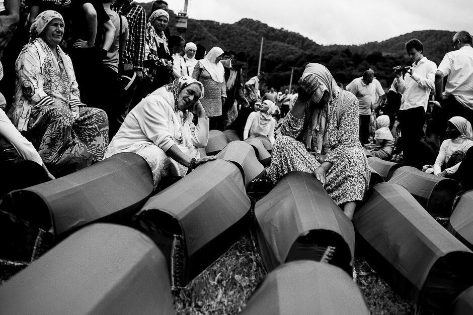 Mothers and grandmothers mourning newly identified victims of genocide in at the Srebrenica Potočari Memorial site.
