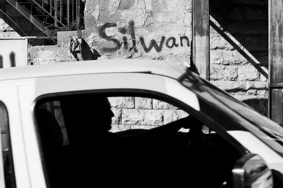 Car driving through Silwan in East Jerusalem .