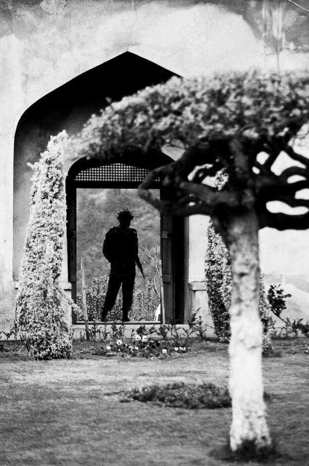 Indian soldier in a mughal garden overlooking Srinagar, the summer capital of Kashmir.