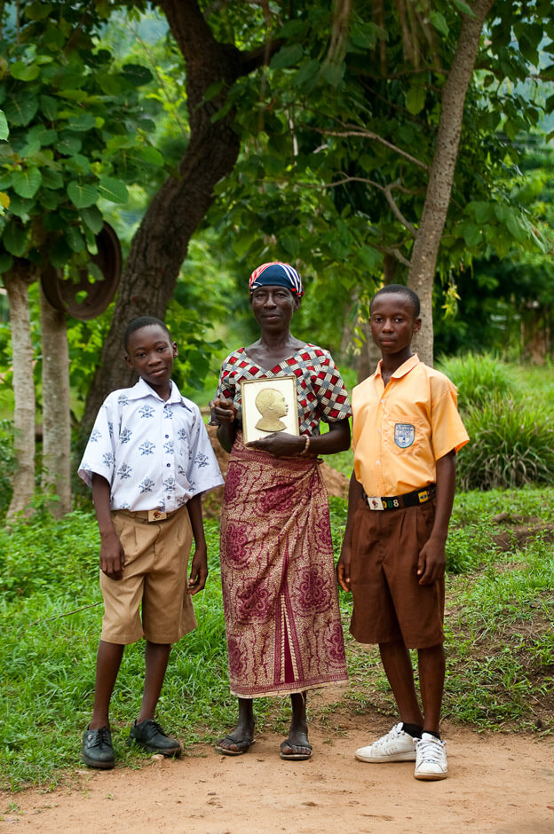 Family with portrait of national hero Kwame Nkrumah in rural in the Volta Region of Ghana.