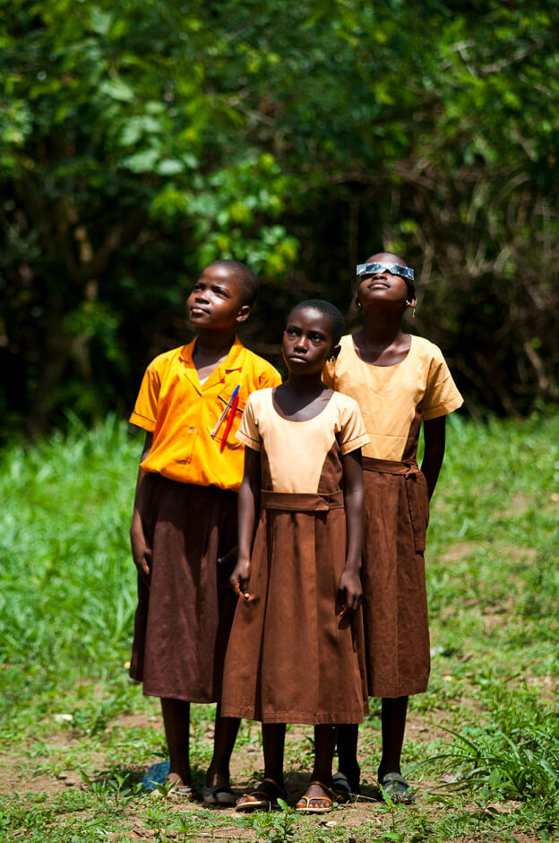 Nkonya girls with special glasses for solar eclipse in rural in the Volta Region of Ghana.