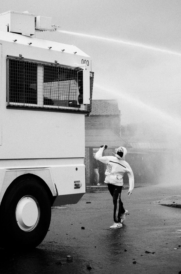 Nationalist rioter stoning a PSNI water canon on the 12th of July in Ardoyne/Belfast.