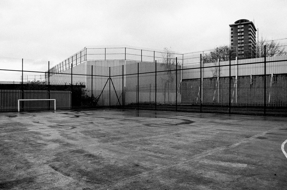 Football pitch at peaceline operating loyalist lower Shankill from nationalist Falls Road.