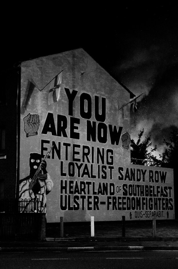 """You are now entering loyalist Sandy Row"" - UVF paramilitary mural on the 11th night in Belfast."
