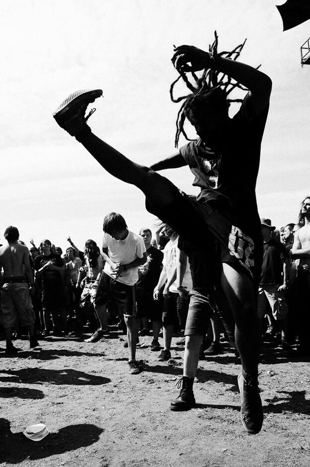 Metal fan with dreadlocks in the mosh pit at Wacken Open Air 2013.