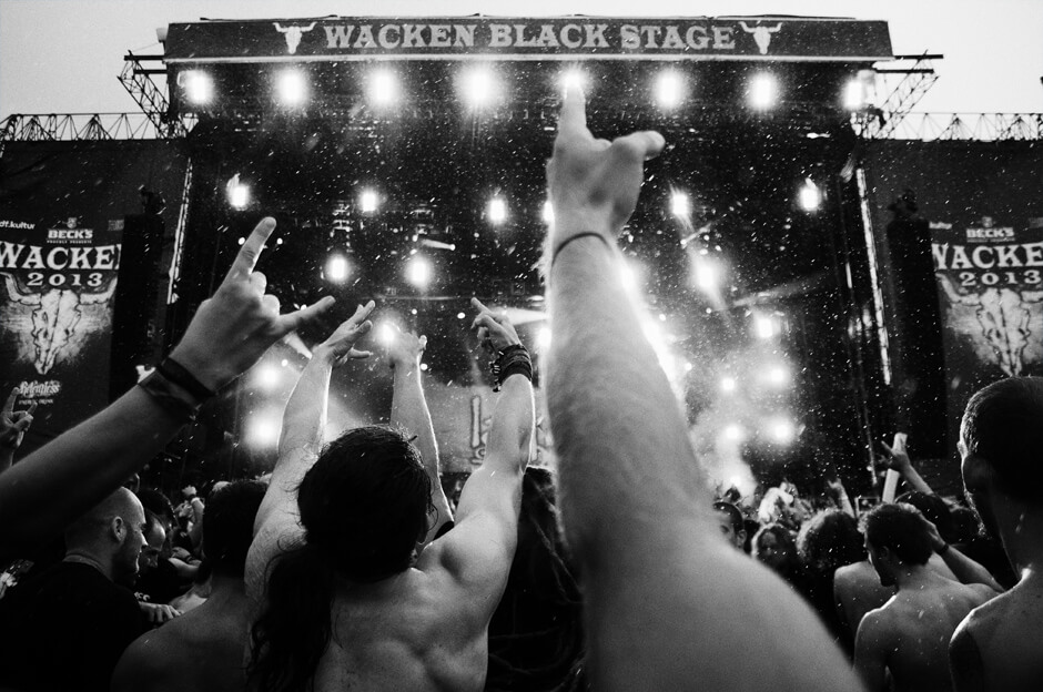 Metal fans in the mosh pit during the rainy set of Lamb of God at Wacken Open Air 2013.