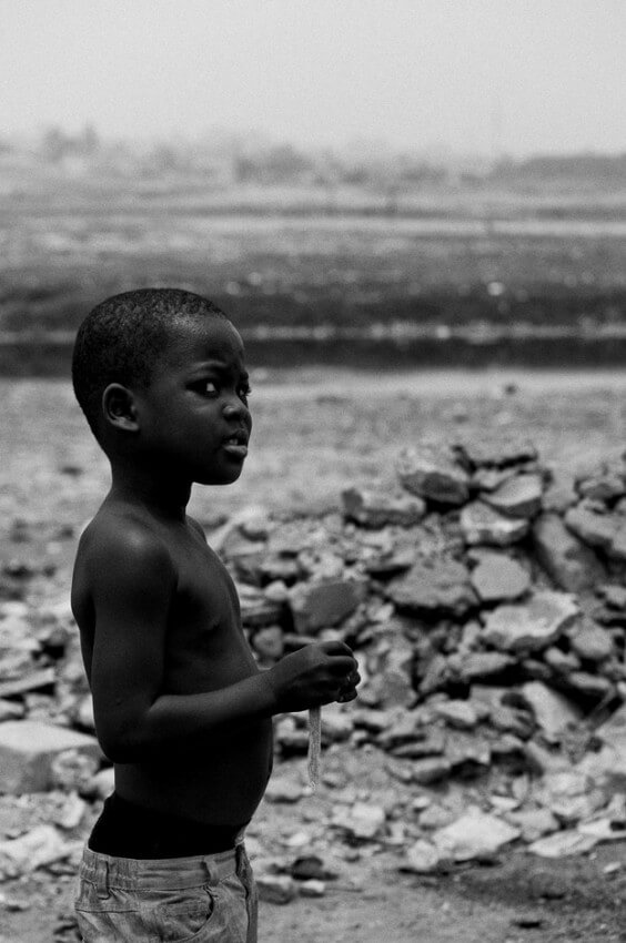 Boy surrounded by trash in the neighbourhood of Agbogbloshie in Ghanas capital Accra, better known by the locals as Sodom & Gomorrah.