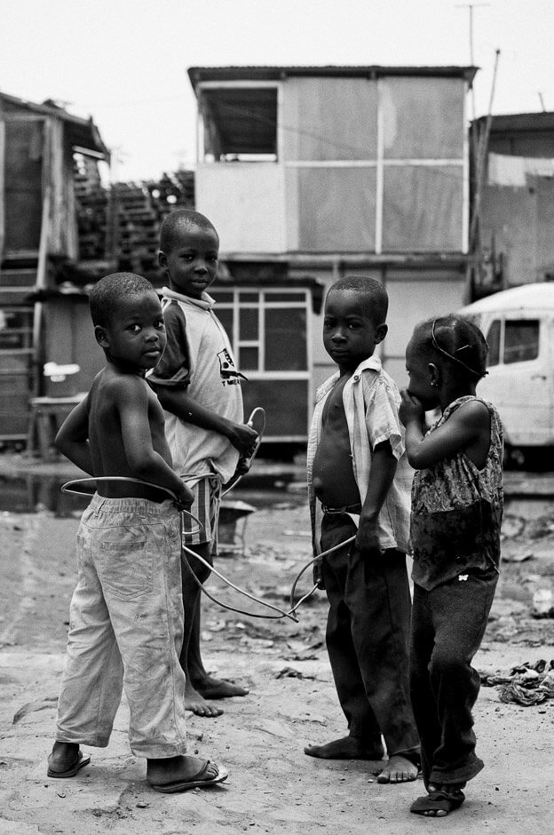 Children playing with cables from electronic trash in the neighbourhood of Agbogbloshie in Ghanas capital Accra, better known by the locals as Sodom & Gomorrah.