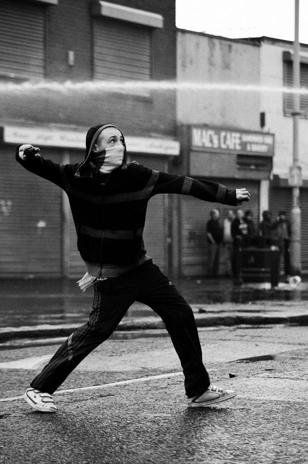 Nationalist rioter stoning the police on the 12th of July in Ardoyne/Belfast.