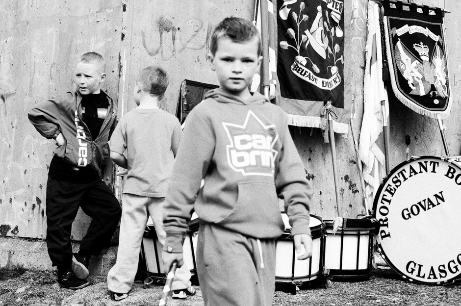 Young Protestant supporters during a pre-parade church service on Denmark Street/Shankill area in Belfast.