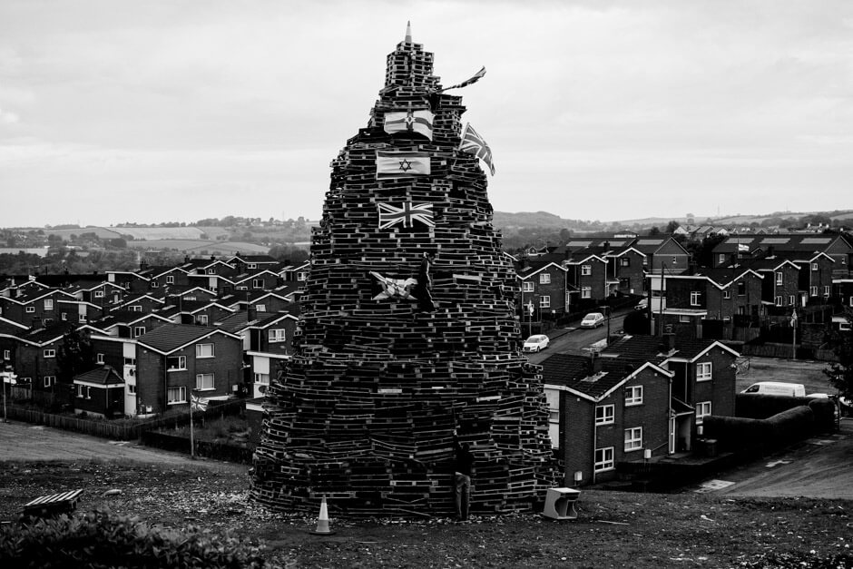 Bonfire decorated with Union Jack, Northern Ireland and Israel flag in Newtownards.