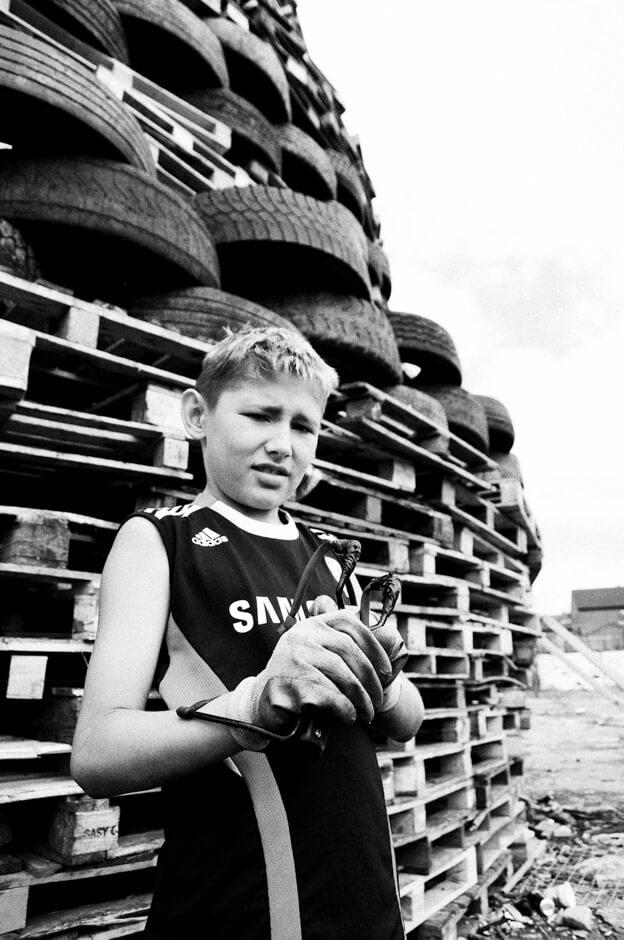 Young Loyalist in front of Lanark Way bonfire in the Shankill area of Belfast.