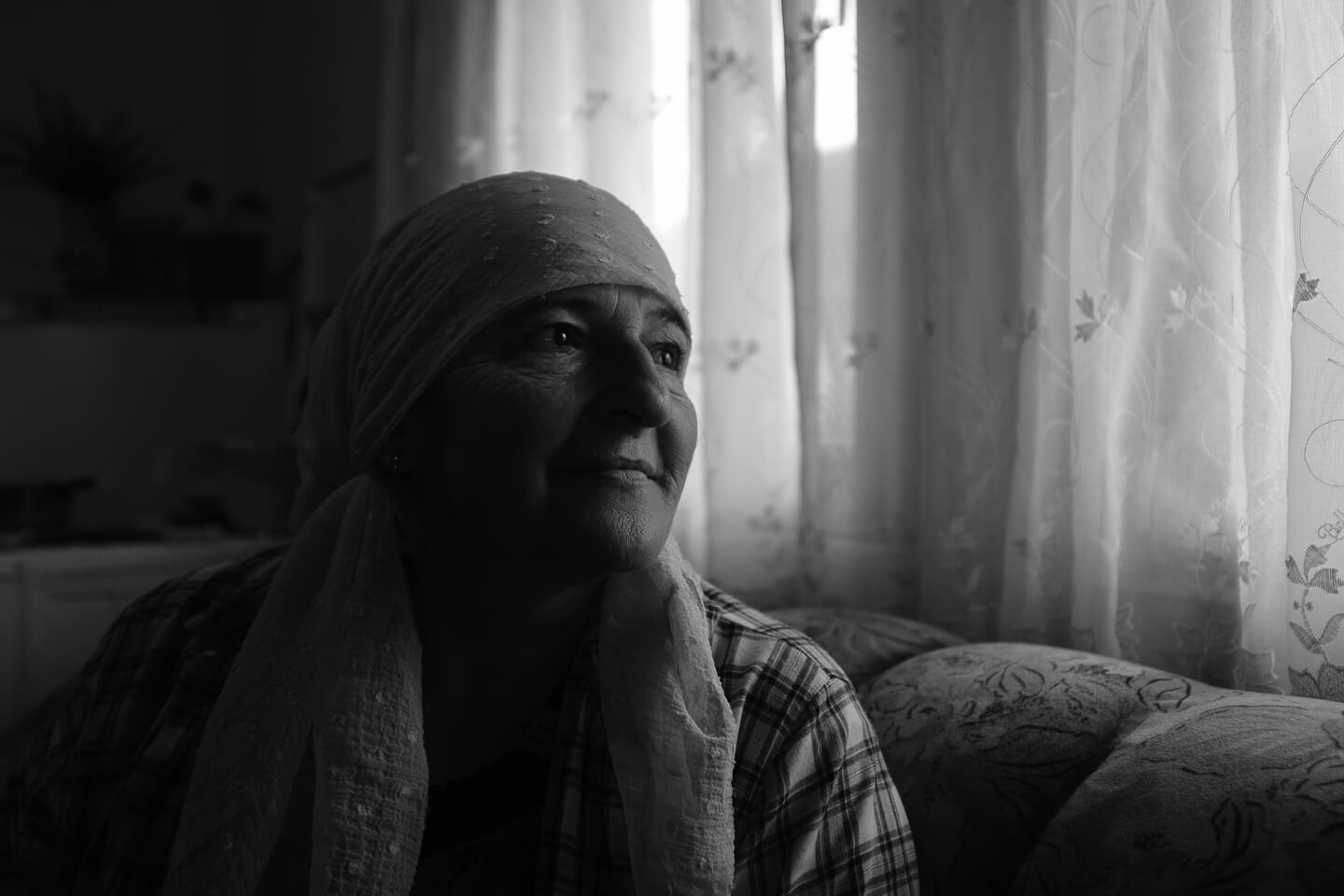 Devleta Omerovi, mother of two adult sons, in her home in a refugee camp in Jezevac.